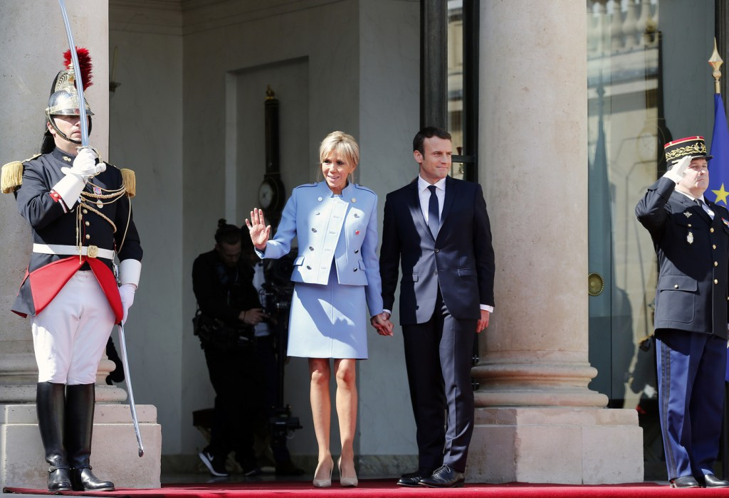 PARIS, FRANCE - MAY 14:  Newly-elected President Emmanuel Macron and his wife Brigitte Trogneux pose on the steps of the Elysee Palace after the handover ceremony with France's outgoing President Francois Hollande on May 14, 2017 in Paris, France. Macron was elected President of the French Republic on May 07, 2017 with 66,1 % of the votes cast.  (Photo by Thierry Chesnot/Getty Images)