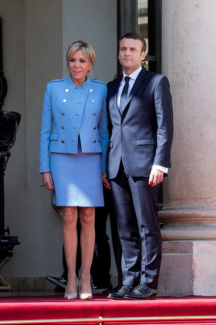 PARIS, FRANCE - MAY 14:  New French President elect Emmanuel Macron (R) and his wife, the First Lady Brigitte Trogneux (L), attend a formal ceremony as part of the transfer of power from French Former President Francois Hollande (not pictured) at the Elysee Palace on May 14, 2017 in Paris, France. Hollande and Macron spoke together for an hour in the Elysee office.  (Photo by Christophe Morin/IP3/Getty Images)