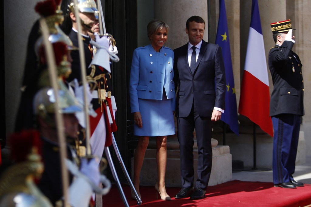 Newly-elected President Emmanuel Macron and his wife Brigitte Trogneux pose on the steps of the Elysee Palace after the handover ceremony with France's outgoing President Francois Hollande on May 14, 2017 in Paris, France. Macron was elected President of the French Republic on May 07, 2017 with 66,1 % of the votes cast.  (Photo by Mehdi Taamallah/NurPhoto via Getty Images)