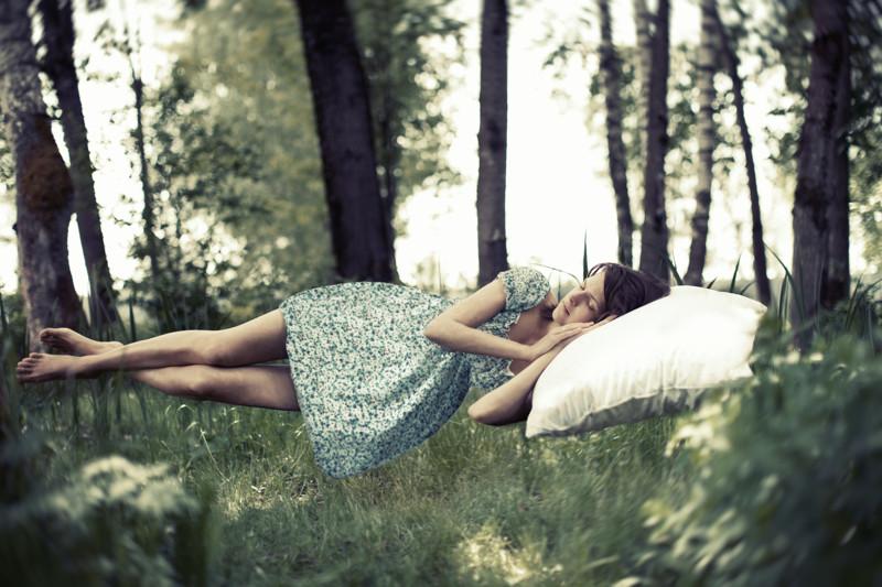 Young woman sleeping, toned image