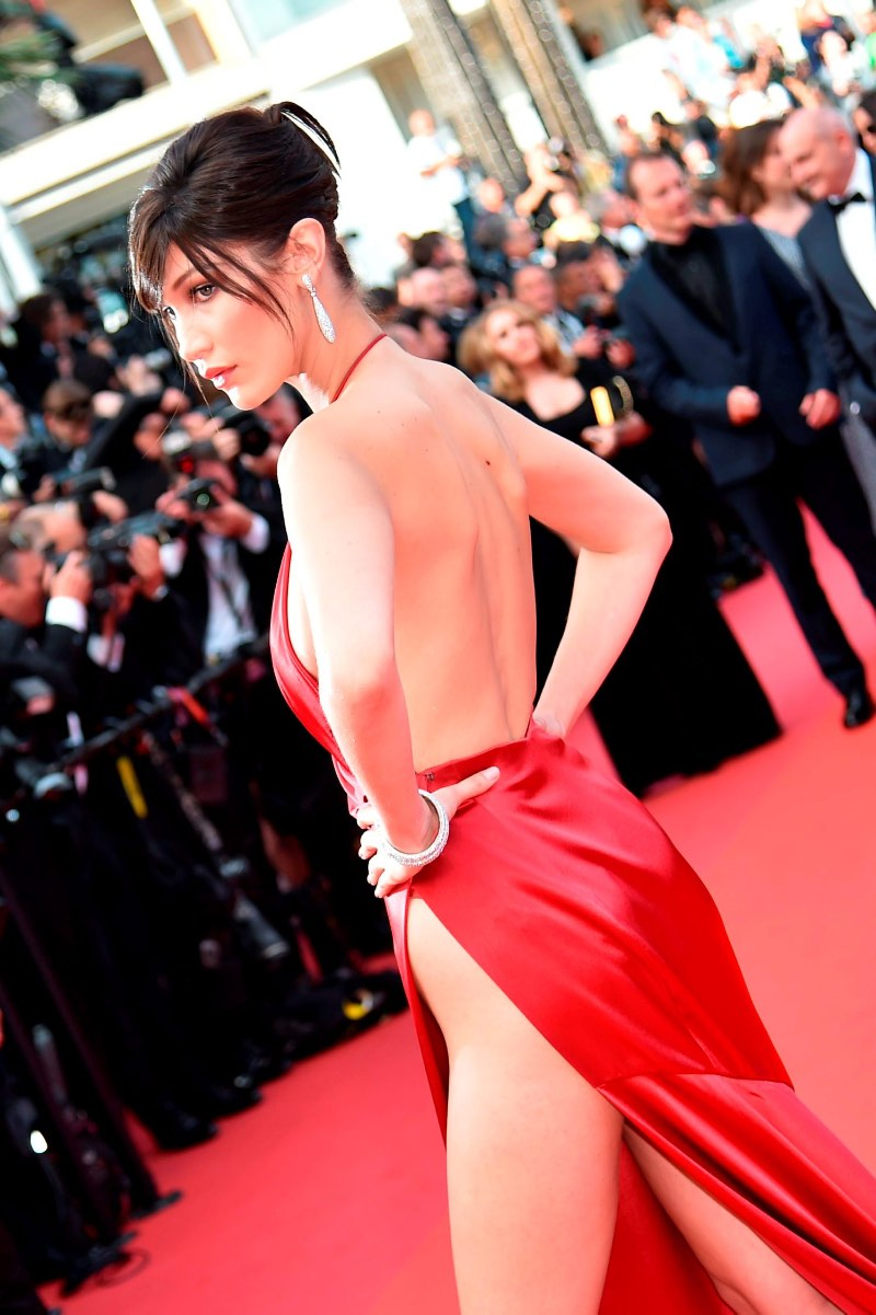 "US model Bella Hadid poses as she arrives on May 18, 2016 for the screening of the film ""The Unknown Girl (La Fille Inconnue)"" at the 69th Cannes Film Festival in Cannes, southern France.   / AFP PHOTO / ALBERTO PIZZOLIALBERTO PIZZOLI/AFP/Getty Images"