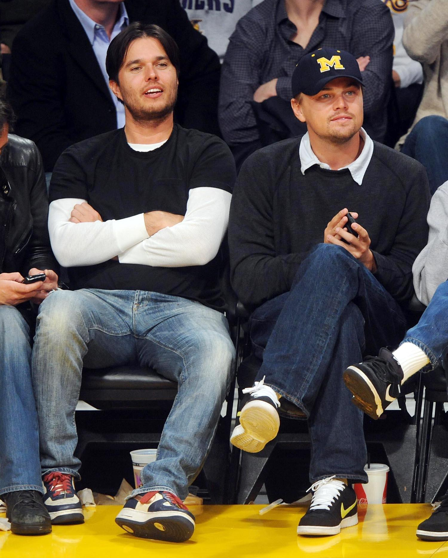 ©2009 credit Gamepiks only Actrors Lucas Hass, Adam Farrar (Leo's brother), Leonardo DiCaprio and Kevin Dilon (L-R) sit courtside as they attend the Los Angeles Lakers/Miami Heat NBA game at Staples Center in Los Angeles on December 4, 2009. The Lakers defeated the Heat 108-107 with a three-point shot by Kobe Bryant at the buzzer. XYZ (Photo by Philip Ramey/Corbis via Getty Images)