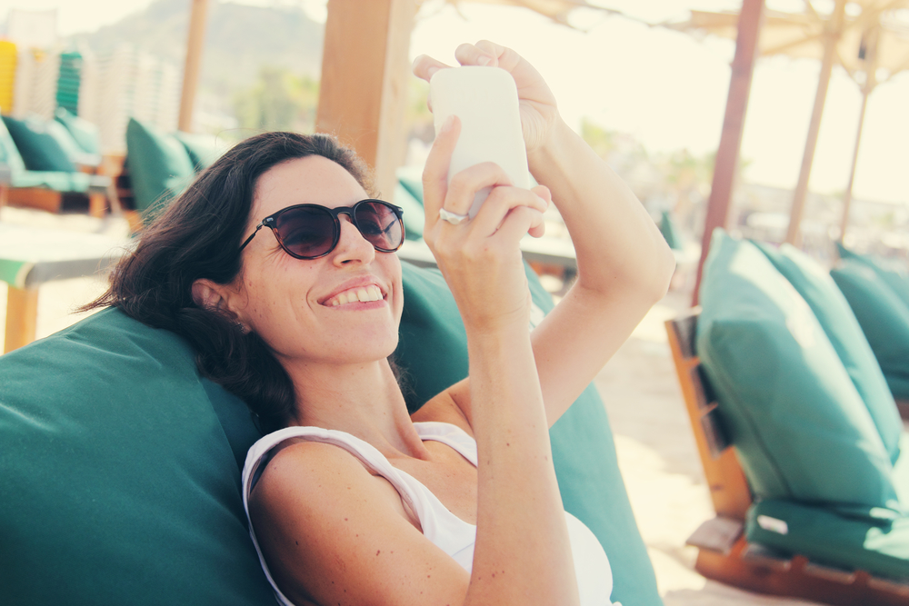 woman with smart phone. Selfie