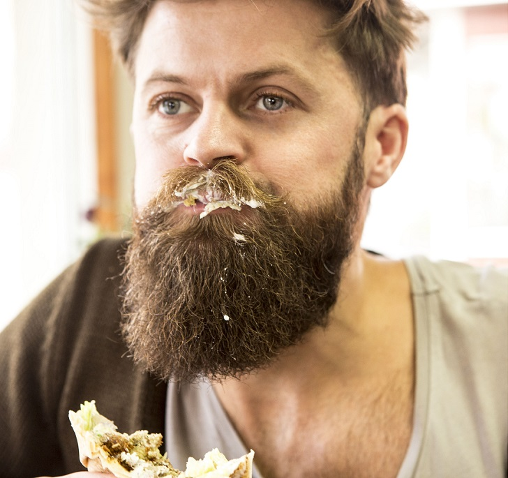 MANDATORY CREDIT: ODD Company/REX Shutterstock. Only for use in this story. Editorial Use Only. No stock, books, advertising or merchandising without photographer's permission Mandatory Credit: Photo by ODD Company/REX Shutterstock (5363213i) Eric, co-founder of ODD Company, with food in his beard The ultimate hipster accessory, Gцteborg, Sweden - 12 Nov 2015 FULL BODY: http://www.rexfeatures.com/nanolink/ri9c A trio of Swedish designers have given hipsters a way of protecting their moustache whilst performing actions such as eating or drinking.  The multifunctional moustache protector, known as the 'Stache Shield', can be placed on drinking containers or worn on the face.  Currently gaining traction on Kickstarter, the designers believe that their creation could be the accessory that hipsters worldwide have been waiting for.