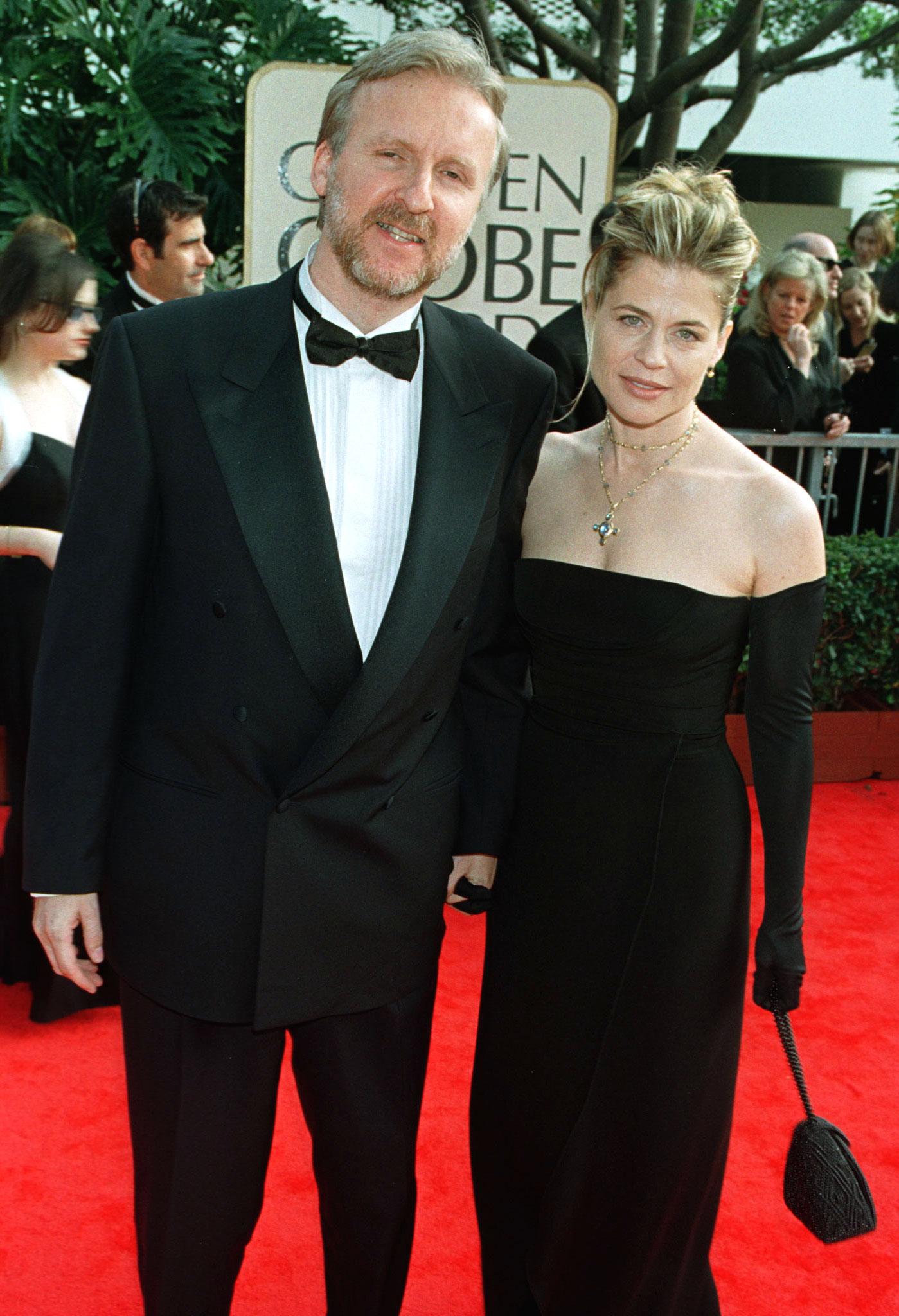 "James Cameron and his wife Linda Hamilton arrive for the 55th annual Golden Globe Awards in Beverly Hills, January 18. The awards, sponsored by the Hollywood Foreign Press Association, honors excellence in film and television. Cameron's film ""Titanic"" is nominated for numerous awards. Hamilton was his star in the ""Terminator"" series. - RTXIMB8"